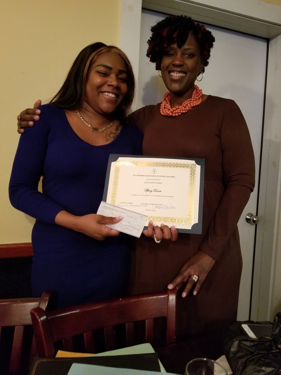 Nursing Student scholarship award recipient and the Scholarship Committee chair.