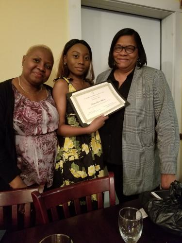 Mother and friend with scholarship recipient.